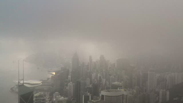 cloudy morning drone aerial view hong kong city skyscraper buildings - modern city business district - victoria peak stock videos & royalty-free footage