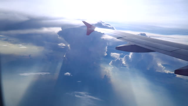 cloudy sky and sunbeam view from plane window - commercial airplane stock videos & royalty-free footage
