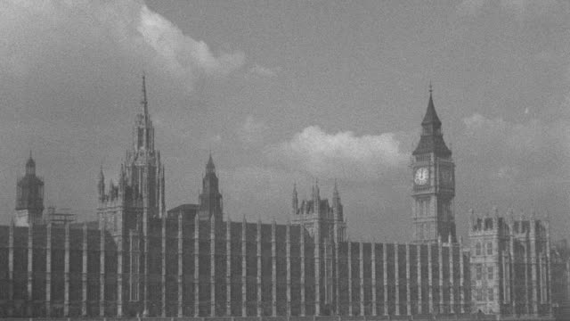 a cloudy sky outlines the houses of parliament. - victoria tower stock videos & royalty-free footage