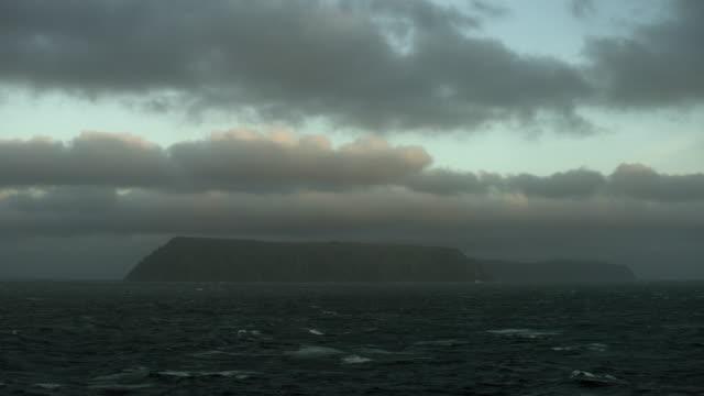 vidéos et rushes de cloudy sky over little diomede island - partie d'une série