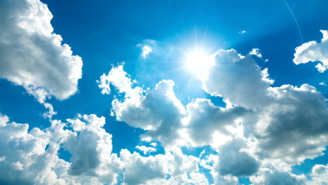 4k tl cloudy sky with sun rays. - sunlight stock videos & royalty-free footage