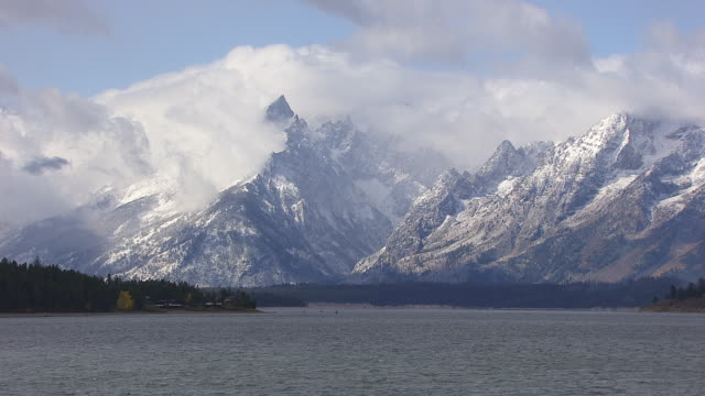 cloudy tetons - jackson hole stock-videos und b-roll-filmmaterial