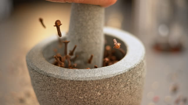 slo mo ld cloves being crushed in a mortar with a granite pestle - mineral stock videos & royalty-free footage