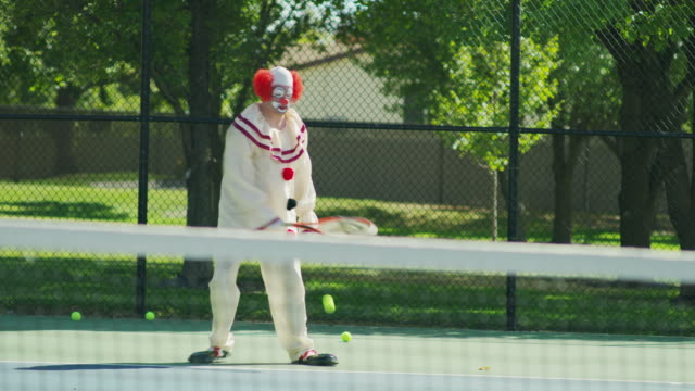 clown awkwardly playing tennis / pleasant grove, utah, united states - clown stock videos & royalty-free footage