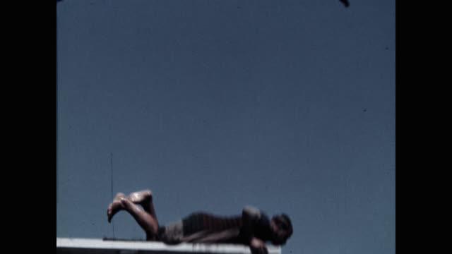 clown diver walking on diving platform against blue sky - diving platform stock videos & royalty-free footage