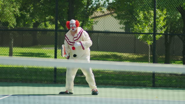 clown flipping racket bouncing tennis ball in anticipation of serving / pleasant grove, utah, united states - clown stock videos & royalty-free footage