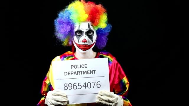 Clown Getting Mugshot Taken