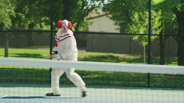 Clown playing tennis laughing and taunting opponent / Pleasant Grove, Utah, United States