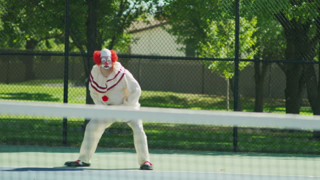 clown playing tennis pointing out of bounds with racket / pleasant grove, utah, united states - clown stock videos & royalty-free footage
