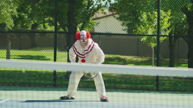vídeos de stock e filmes b-roll de clown playing tennis swinging racket and missing ball / pleasant grove, utah, united states - divertimento