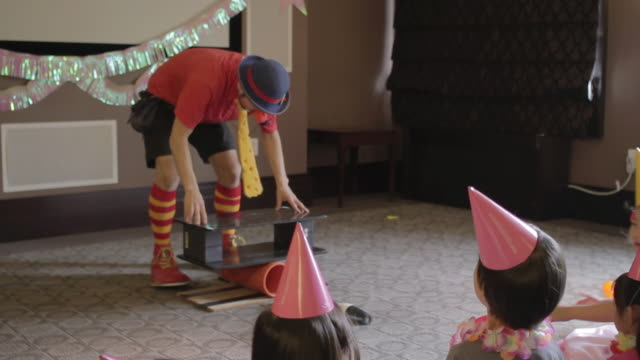 MS TU TD Clown showing funny performances to childerns / New York, United States
