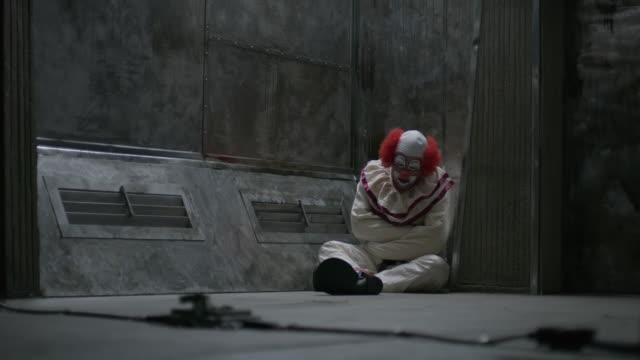 clown sitting on floor of mental asylum wearing straight jacket / cedar hills, utah, united states - clown stock videos & royalty-free footage