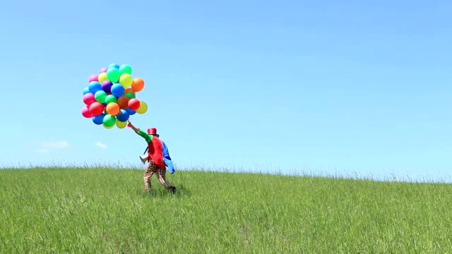 clown with balloons on field - clown stock videos & royalty-free footage