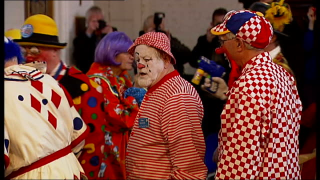 Clowns attend Joseph Grimaldi memorial ceremony in East London ENGLAND London Dalston Holy Trinity Church PHOTOGRAPHY** Various shots of clowns...