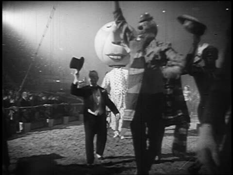 b/w 1955 clowns parading past camera waving in circus tent - circus stock videos & royalty-free footage