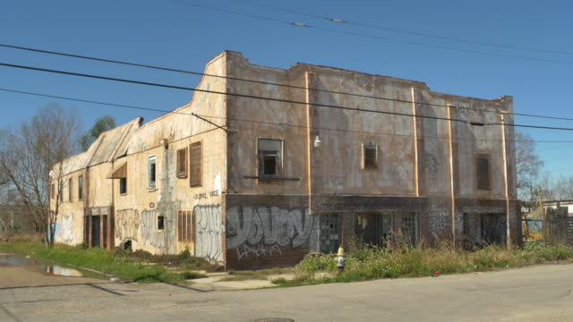 club desire in the 9th ward of new orleans sits abandoned and covered in graffiti on mardi gras' fat tuesday in 2016 - new orleans mardi gras stock videos and b-roll footage
