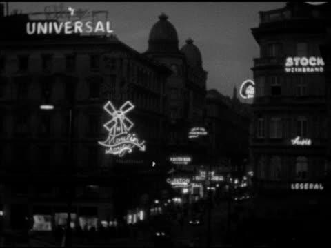 vidéos et rushes de club neon signs, moulin rouge neon windmill sign on building, vs neon signs 'kaiser bar', 'carlton espresso', '3 husaren restaurant + bar', 'casanova... - autriche