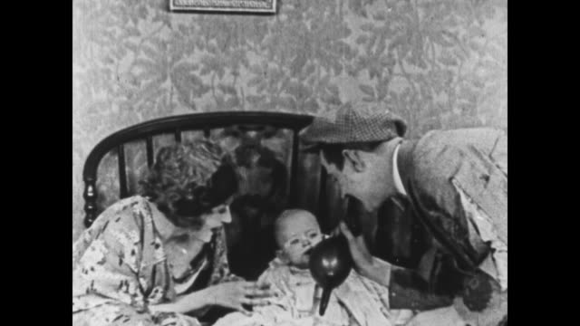 1925 Clueless couple attempt to feed baby a lobster before using rubber gloves to feed him milk instead