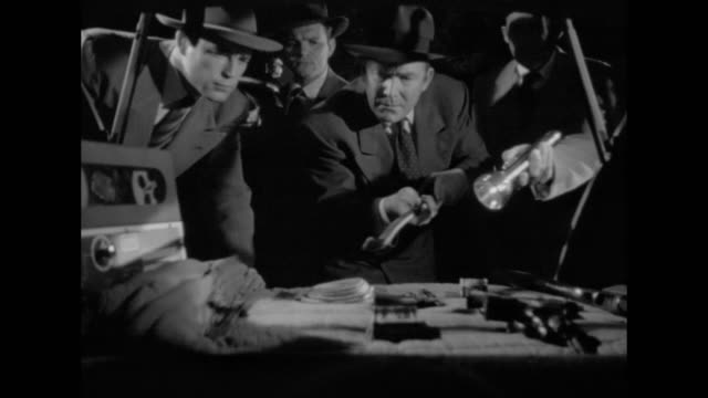 1948 clues are found when officers search the scene of a crime - criminal investigation stock videos & royalty-free footage