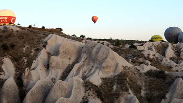 cluster of colorful hot air balloons shot from below - cappadocia, turkey - basalt stock videos & royalty-free footage