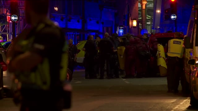 A cluster of emergency service workers responding to the London Bridge terror attack of the 3rd June cluster together near the scene London UK