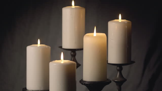 cluster of five candles on canvas - pastor stock videos & royalty-free footage