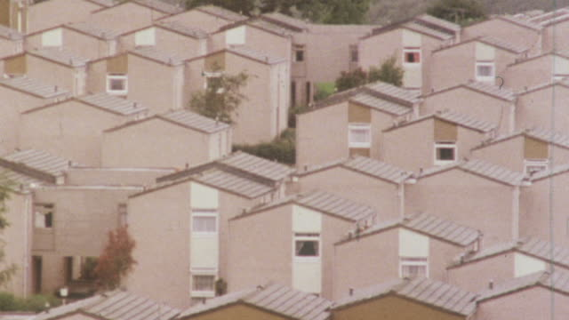 1980 montage cluster of semi detached houses, rows of terraced housing, and residential suburbia / united kingdom - doppelhaus stock-videos und b-roll-filmmaterial