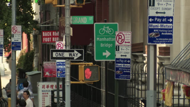 ms cluster of signs on way to manhattan bridge / new york city, new york, usa - chinatown stock videos and b-roll footage