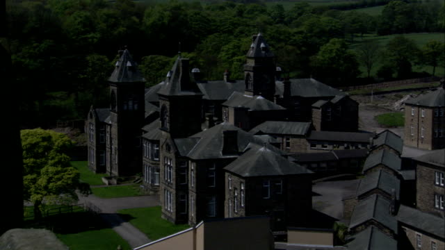 vidéos et rushes de cluster of victorian buildings forming high royds former psychiatric hospital, yorkshire available in hd. - hôpital psychiatrique