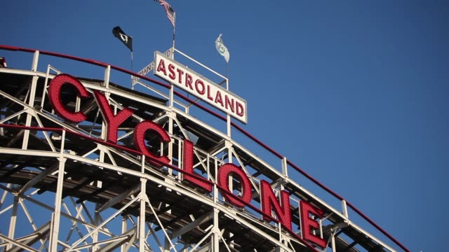 tight shot - clyclone roller coaster ride at coney island, brooklyn, ny usa - coney island stock-videos und b-roll-filmmaterial