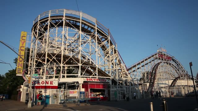 wide shot - clyclone roller coaster ride at coney island, brooklyn, ny usa - wide stock videos and b-roll footage