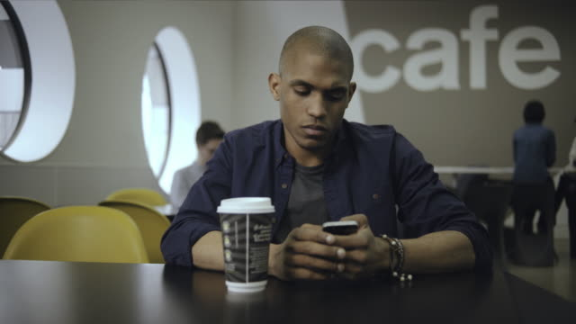 co workers meeting in cafe - disposable cup stock videos and b-roll footage
