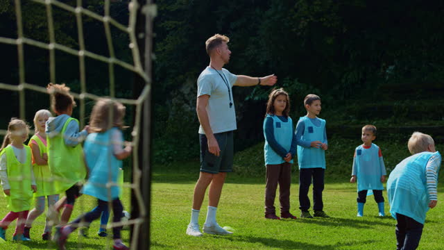coach and little league soccer players during practice - teaching stock videos & royalty-free footage