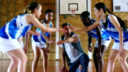 Coach and schoolkids forming hand stack 4k