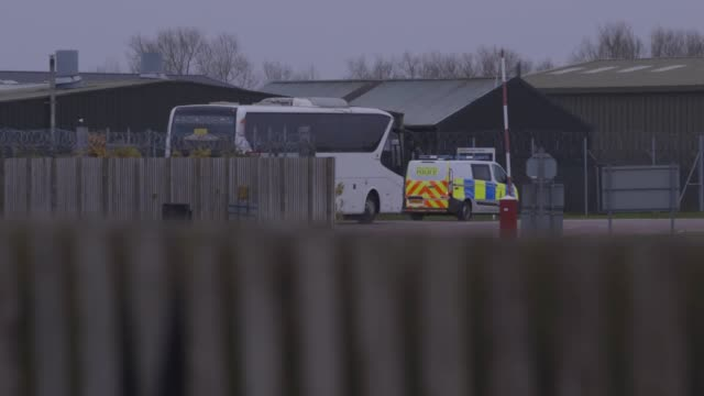 a coach arrives at raf brize norton in oxfordshire ahead of the repatriation of british nationals to the uk from the coronavirushit city of wuhan in... - repatriation stock videos & royalty-free footage