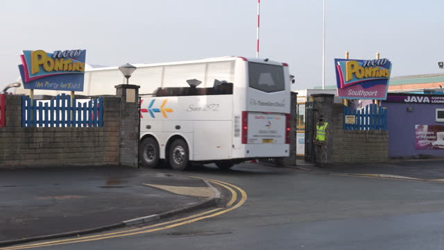 coach bus entering holiday camp where armed forces are based to help with covid-19 testing in southport, merseyside, uk, on friday, november 6, 2020. - holiday camp stock videos & royalty-free footage