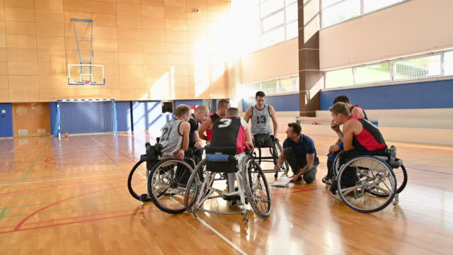 coach diagramming plays for male wheelchair basketball team - wheelchair basketball stock videos & royalty-free footage