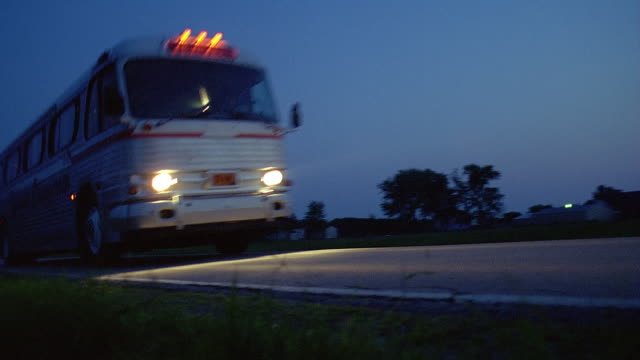 ws la pan ts coach driving along country road, new york state, usa - weitwinkelaufnahme stock-videos und b-roll-filmmaterial