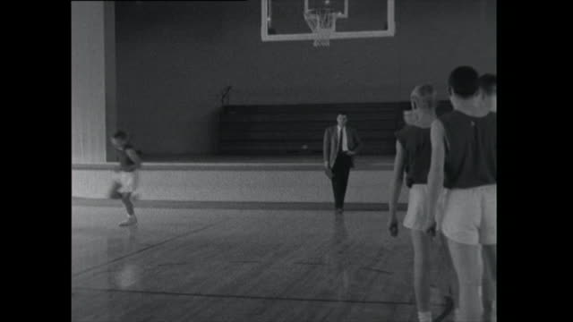 coach gathers basketball team together after practice - sports training drill stock videos & royalty-free footage