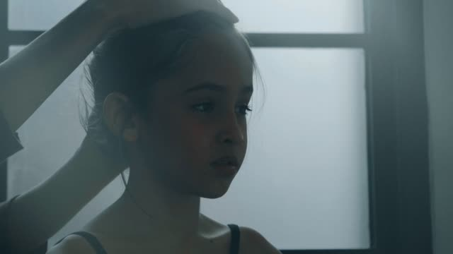 coach helping little ballerina to tie her hair - stock video - ballet dancer stock videos & royalty-free footage