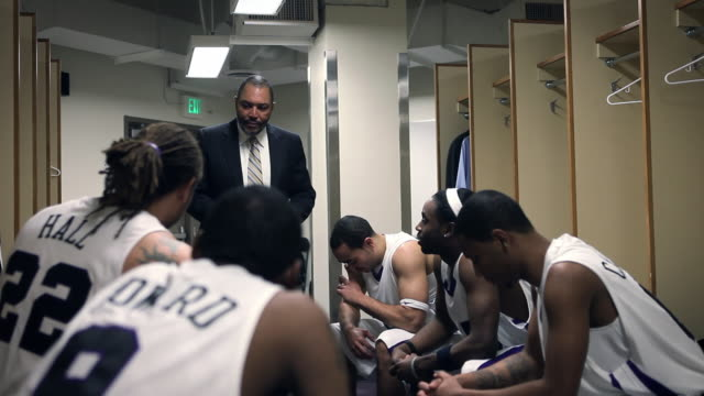 ms coach in discussion with professional basketball players in locker room / washington, usa - locker room stock videos and b-roll footage