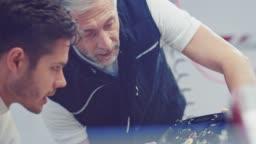 Coach teaching controls of handwheel to racer