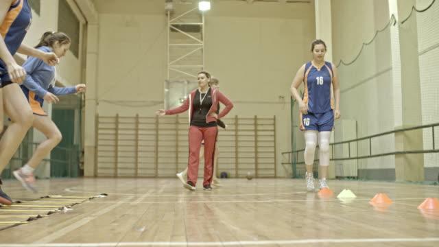 Coach training female basketball players