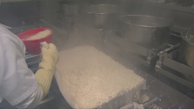 coagulated soy milk in a tofu frame at a factory - soy milk stock videos and b-roll footage