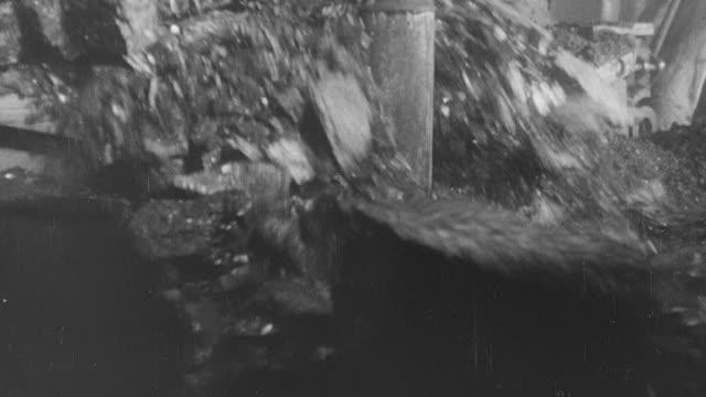 1964 b/w coal being mined through modern mechanization / united kingdom - 炭鉱点の映像素材/bロール