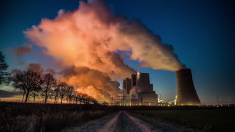 time lapse: coal burning power plant - tracking shot - fumes stock videos & royalty-free footage