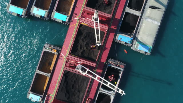 coal cargo ship working in the sea - anchored stock videos & royalty-free footage