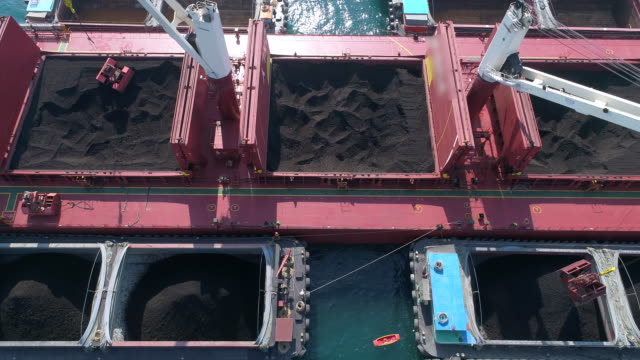 coal cargo ship working in the sea - unloading stock videos & royalty-free footage