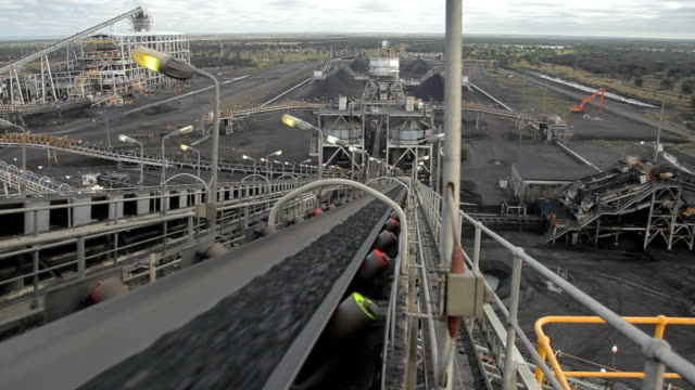 coal conveyor rapidly moving coal at a coal mine. - conveyor belt stock videos & royalty-free footage