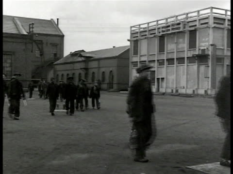 coal factory train ws french factory workers exiting factory buildings ha ws crowd of miners communist leader maurice thorez at podium la ws thorez... - 発電所関係の職業点の映像素材/bロール